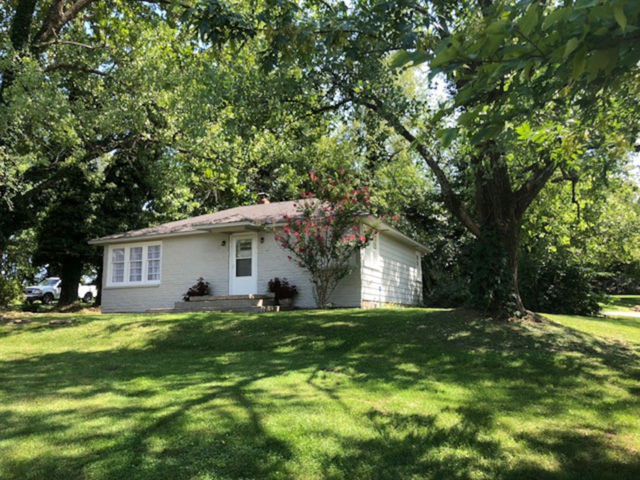 """The """"Little House"""" is a wonderful getaway from your busy life to relax and enjoy the quaint town of Mansfield MO.  It is on an acre lot with beautiful tree and train tracks at the far end.  Newly renovated."""
