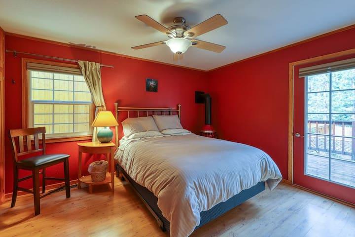 Master bedroom with door to back deck