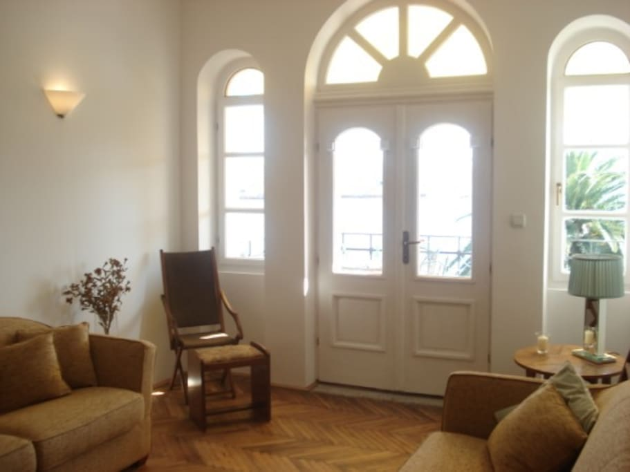 Art deco sitting room with doors to the balcony with 180 degree views of the bay