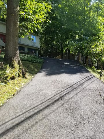 Sorry steep driveway, can be scary, may park on top to the side of garage or on the shoulder. Plenty of room on the shoulder. It is one of the reason we keep the price reasonable.