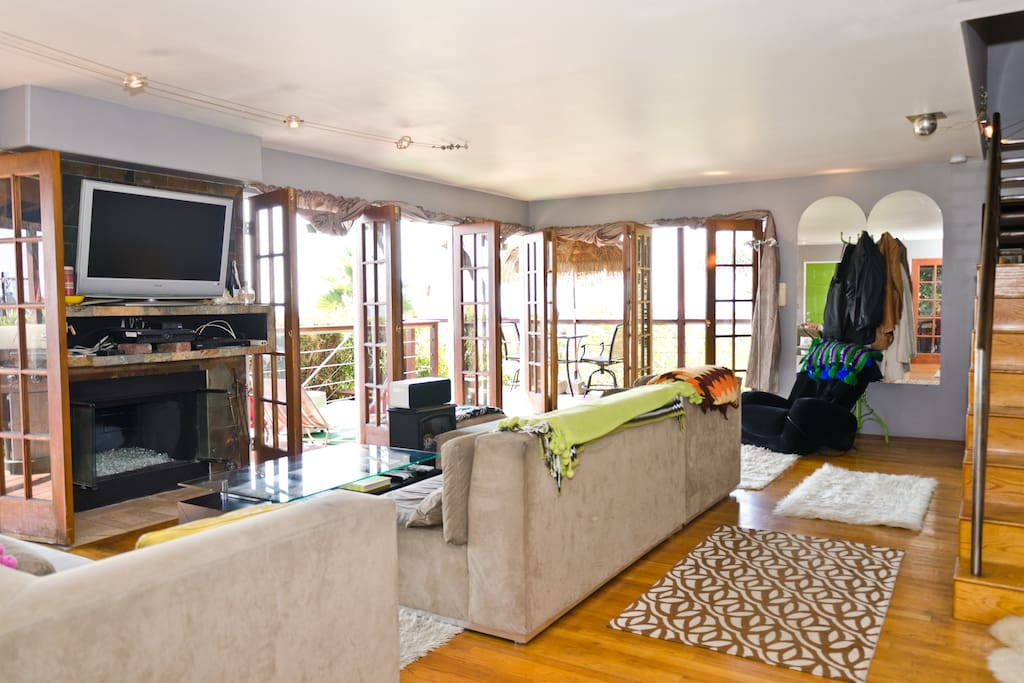Large lving room with fireplace, massage chair, and flat screen tv