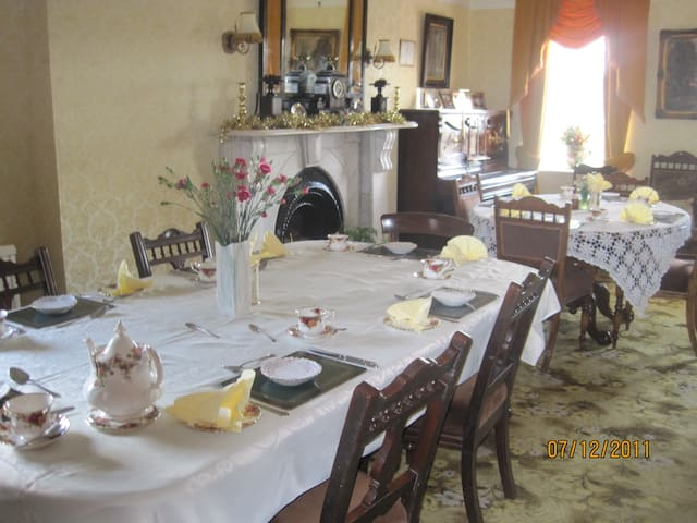 The dining room set for a full Irish breakfast
