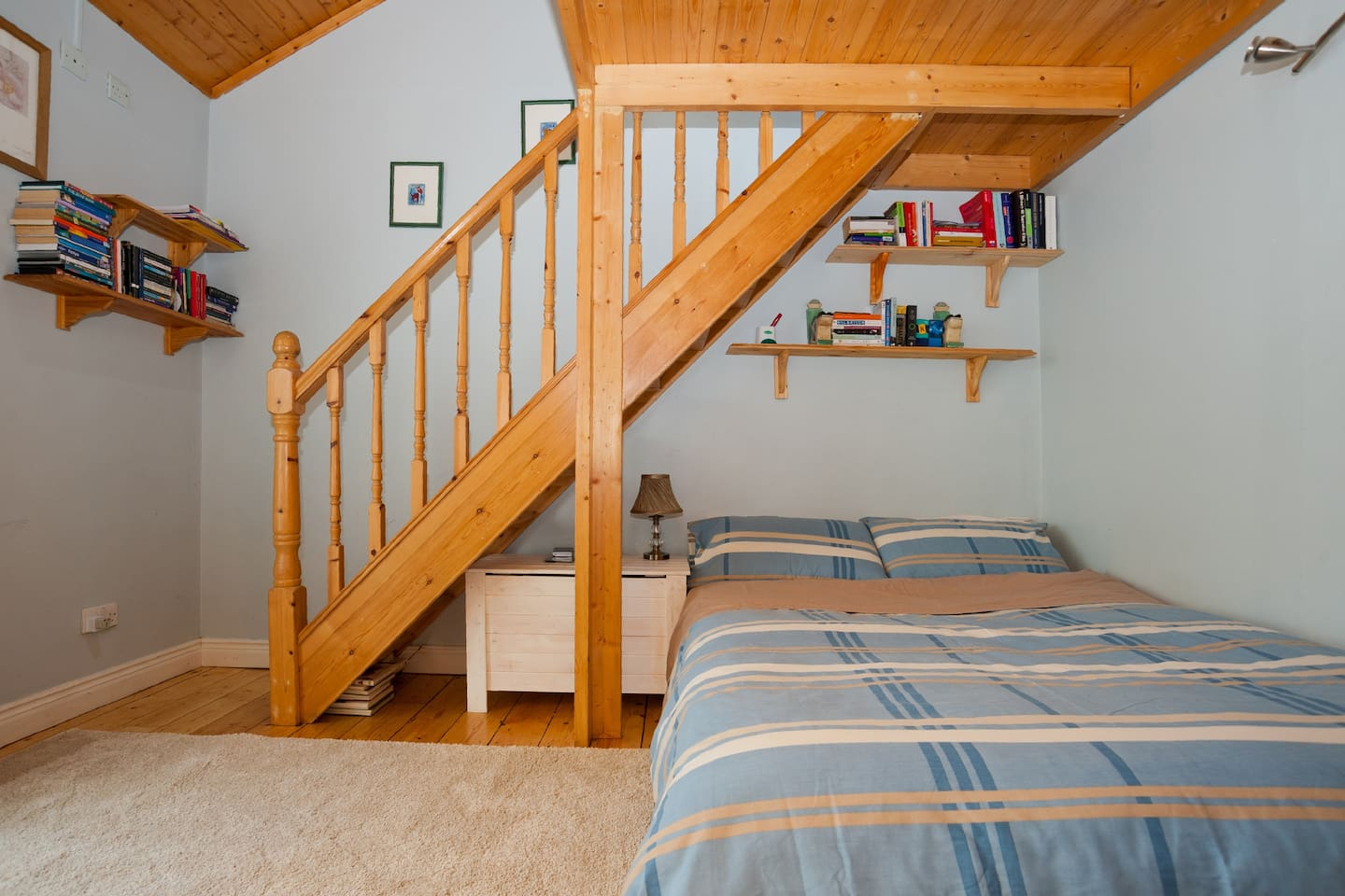 Ground area of this light filled space, with double bed and stairs to the loft, where you'll find a single bed..