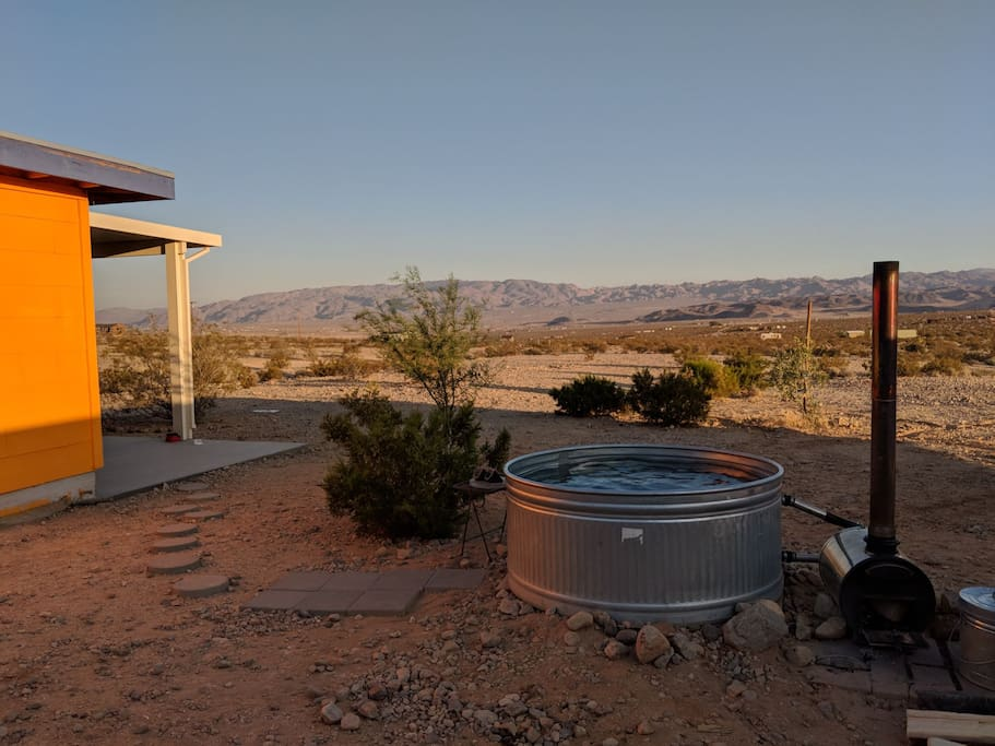 Hot tub doubles as a cool soak, oversized porch looks out onto Indian Cove in Joshua Tree National Park