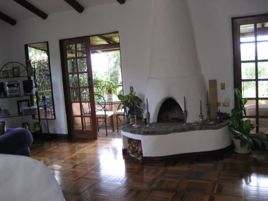 Santa Fe styled home with cathedral beamed cielings and fireplace.