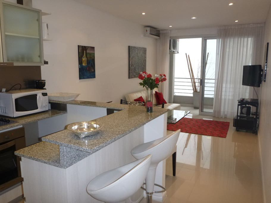 Large fully equipped kitchen. Microwave, electric stove, coffee maker, electric jug, refrigerator with freezer, cutlery.