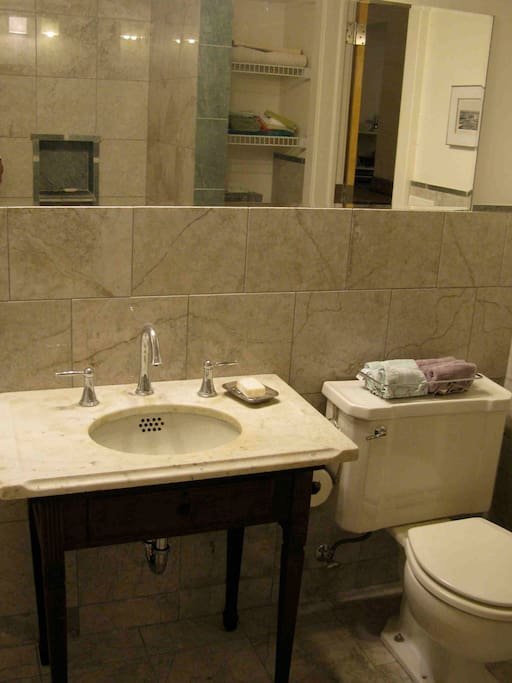 marble bath with vintage sink, tub and shower, towels