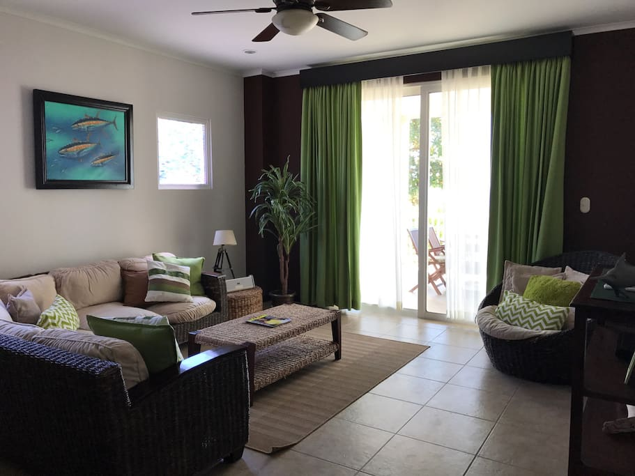 Spacious and comfortable living area beach front, opens to large patio