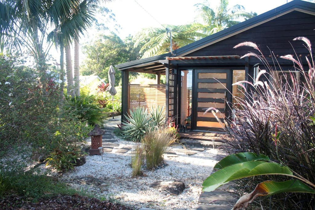 Ferns, grasses and Bangalow Palms are features of the garden.