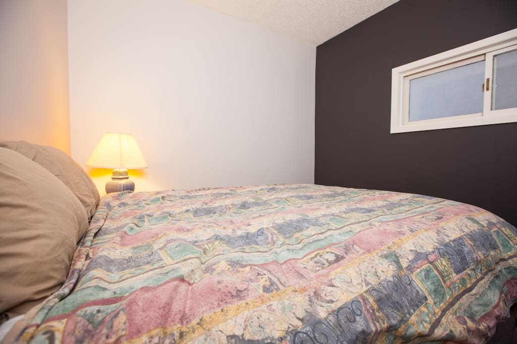 Upstairs Bedroom. Comfortable queen size bed has excellent back support.