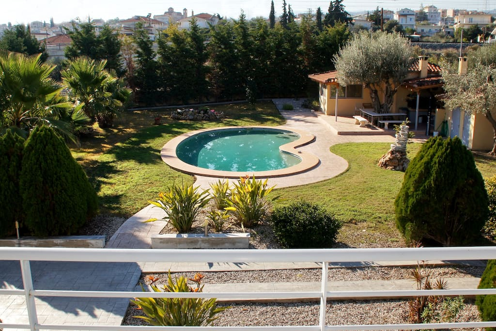 View of the pool and front yard, from the terrace / balcony.