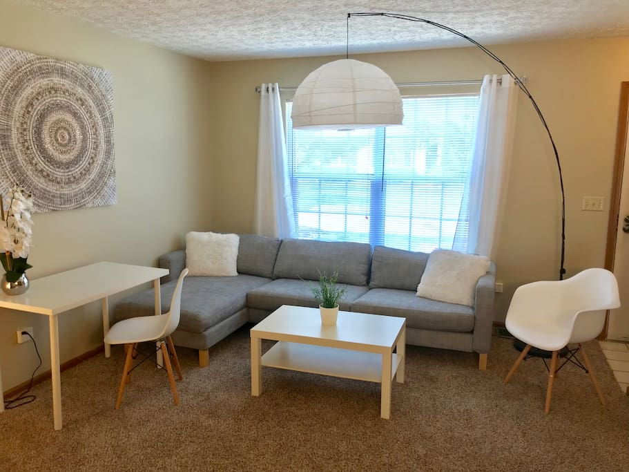 "Living room with comfy couch, desk and chair, cable TV with Netflix, and super fast internet WiFi. Quote from prior guest:  ""It seems like he recently renovated as all the furnishings were new! I even loved the place down to the carpet!"""