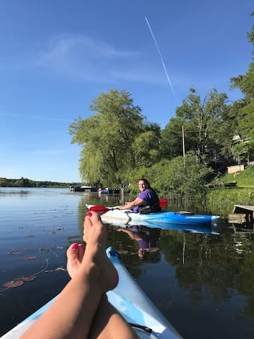 For those wishing to give kayaking a try... I can show you the way! This is the lake behind my house with my feet up as I teach a new friend how to kayak!