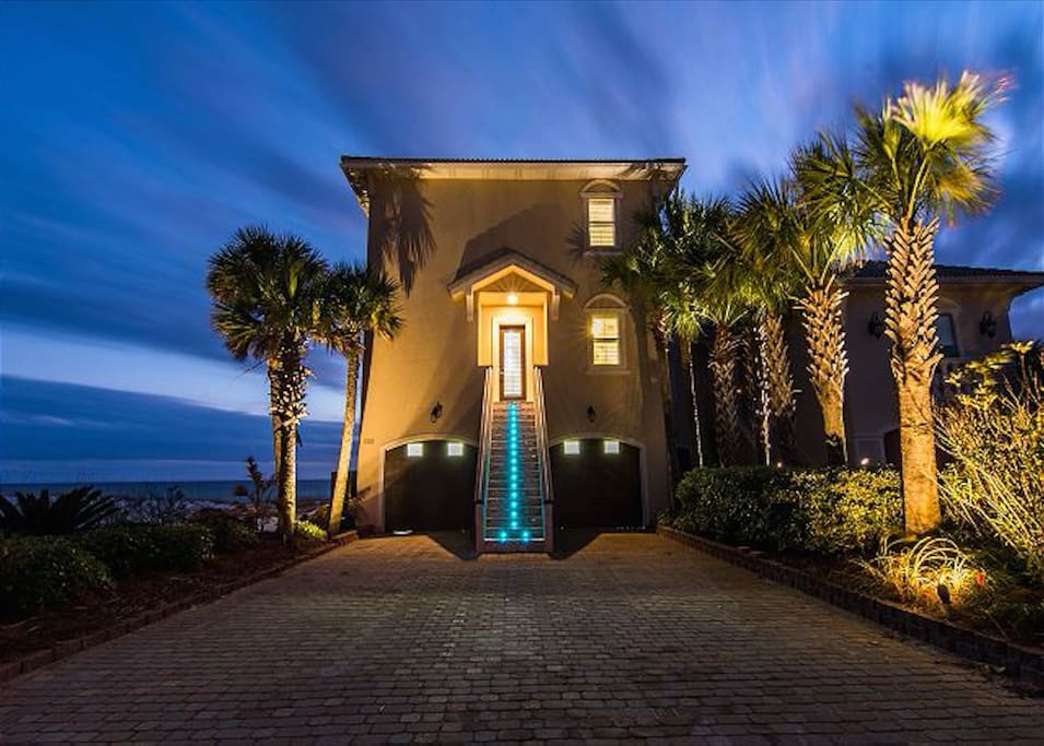 Front view of luxury home at night