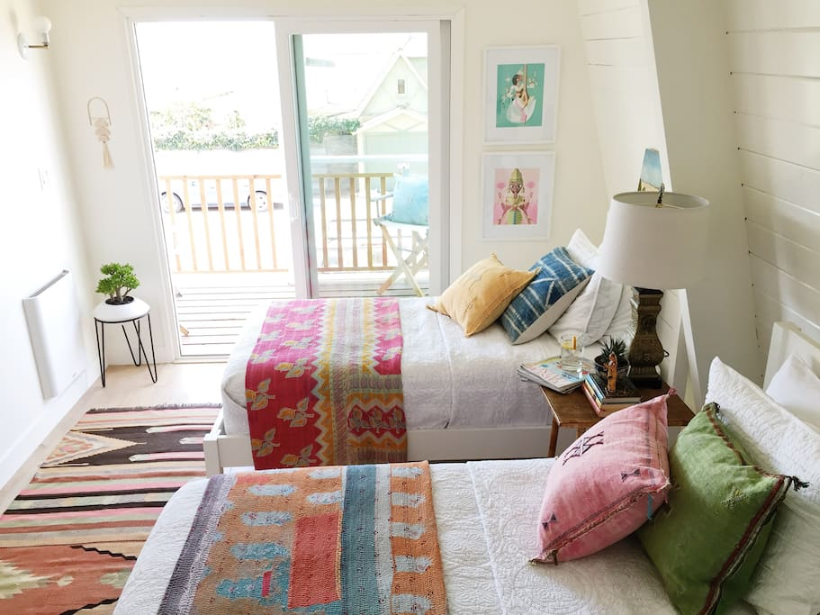 The 2nd bedroom has 2 twin beds, a peek-a-boo ocean view, and a covered balcony that lets in the ocean breeze and the sound of the waves lull you to sleep.