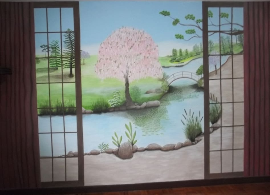 A beautiful mural on one wall of the bedroom