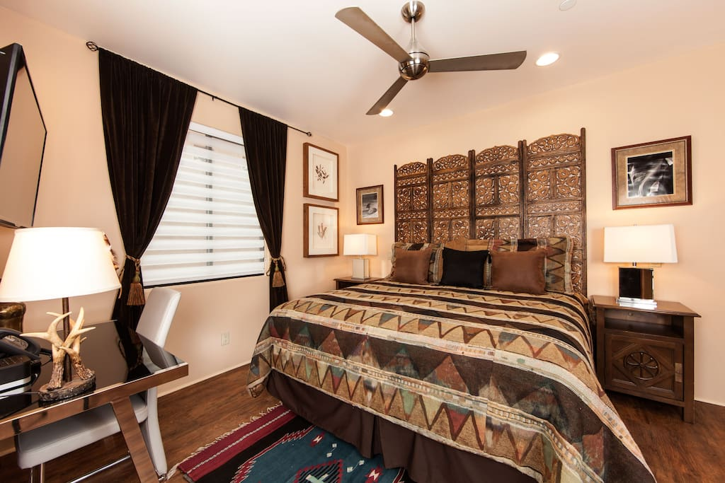 This luxurious master bedroom has a king sized bed, HDTV, IPod dock, desk, and a large closet.