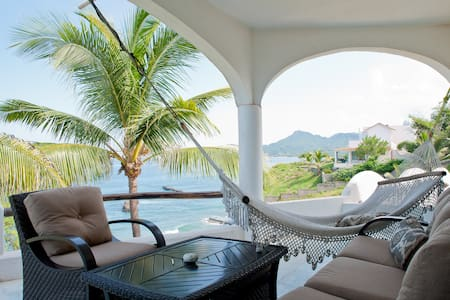 This Ocean front house offers spectacular views, great swimming, snorkeling and surfing .  A place to relax and enjoy nature from every corner of the house. It is located on Playa Careyeros, in between Punta de Mita and Sayulita.   A car is necessary