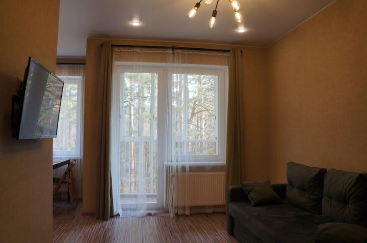 Новая квартира с видом на сосновый лес