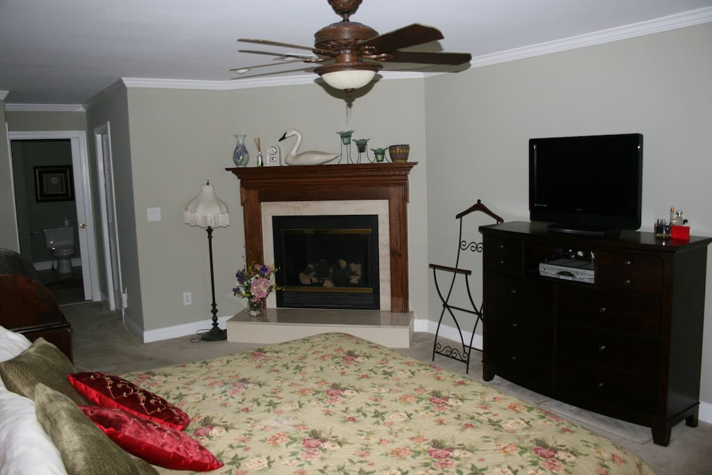 master suite with fireplace, master bath, flat screen TV and King size bed