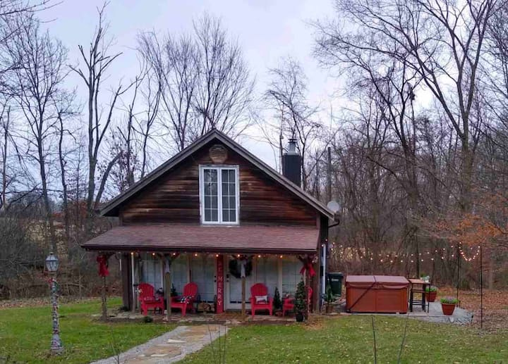 Cabin w/ hot tub near skiing, fishing & racetrack!