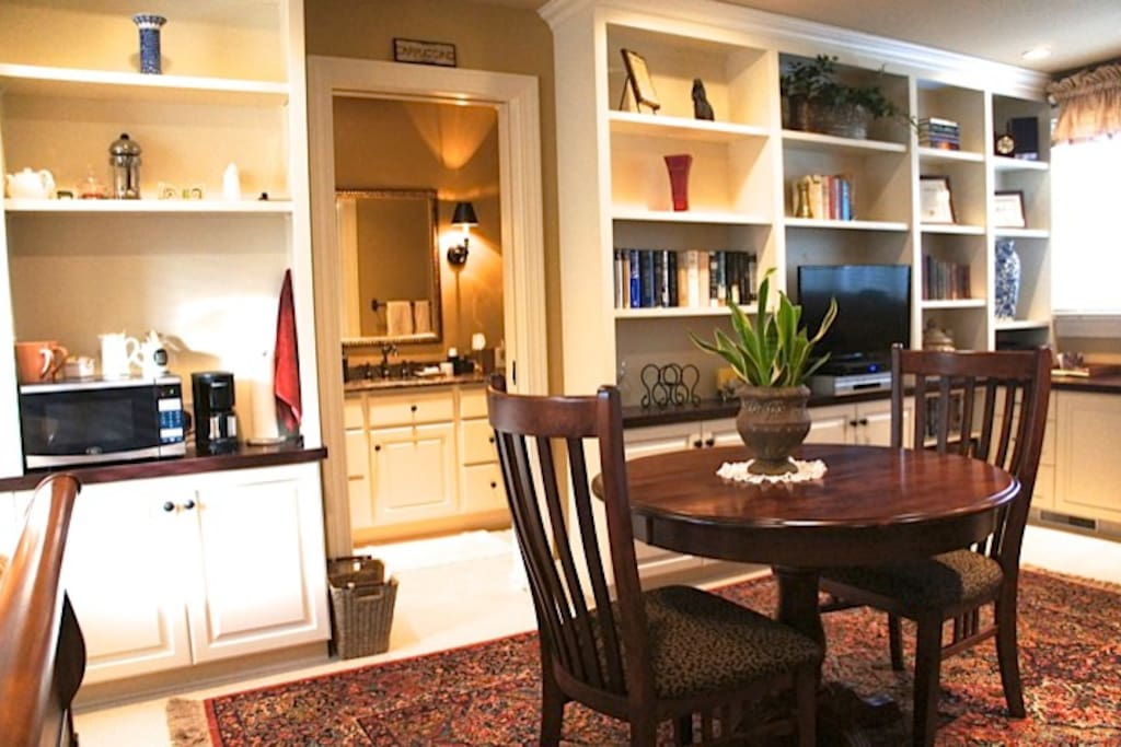View of dining area with coffee pot and microwave on left.
