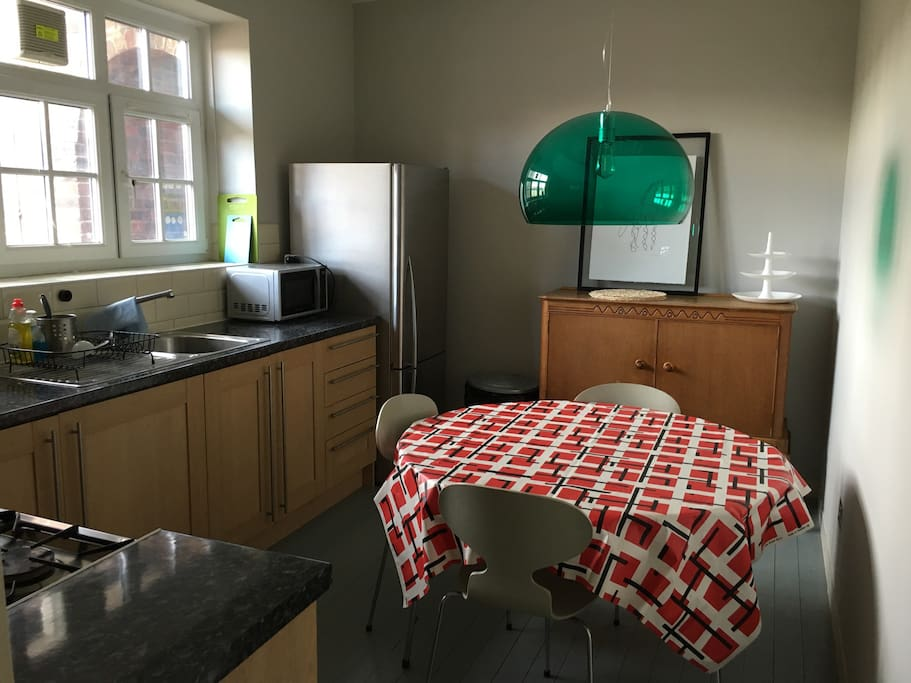 The kitchen is bright and has room for a dining table