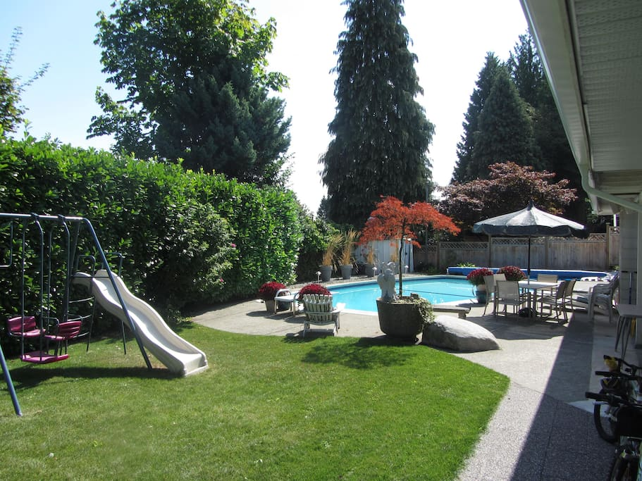 Enjoy the backyard's barbeque, or take time to laze by the pool.