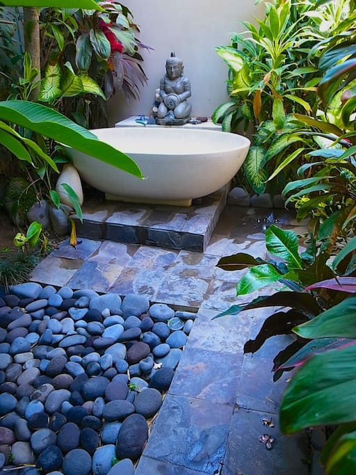 Out door garden Bath to enjoy fresh plumeria flowers over he'd while you bathe..