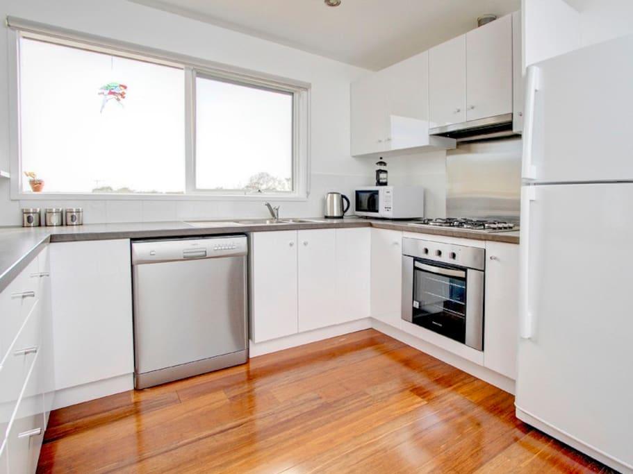 Spacious kitchen with new appliances