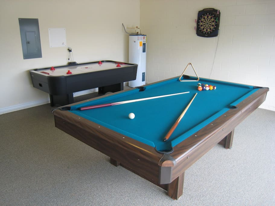Games room with pool table, air hockey and darts.