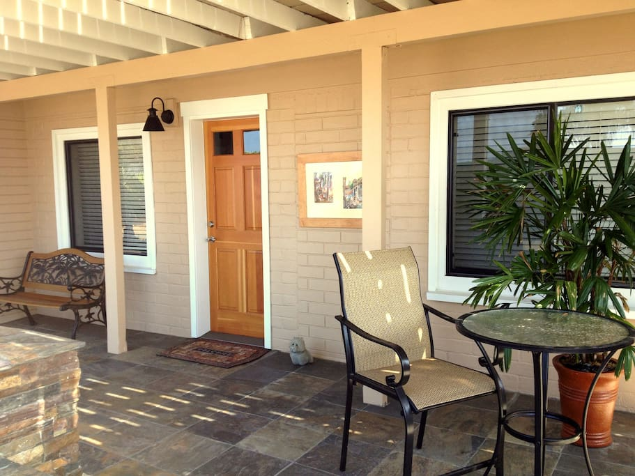 Have a seat for your morning coffee on the front porch
