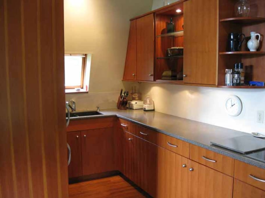 The fully equipped kitchen (dish-washer, oven, stove, food processor, mixer, microwave, everything you could want
