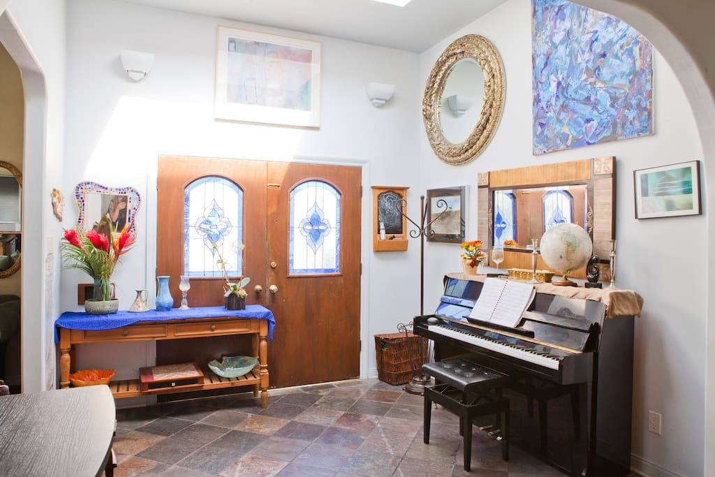 Skylight fill Foyer with light. Upright piano. Feel free to play!