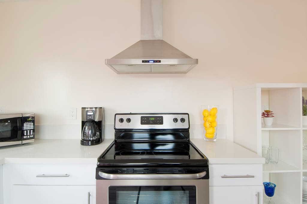 New kitchen with brand new stainless steel appliances and fully stocked for cooking your favorite meals away from home.