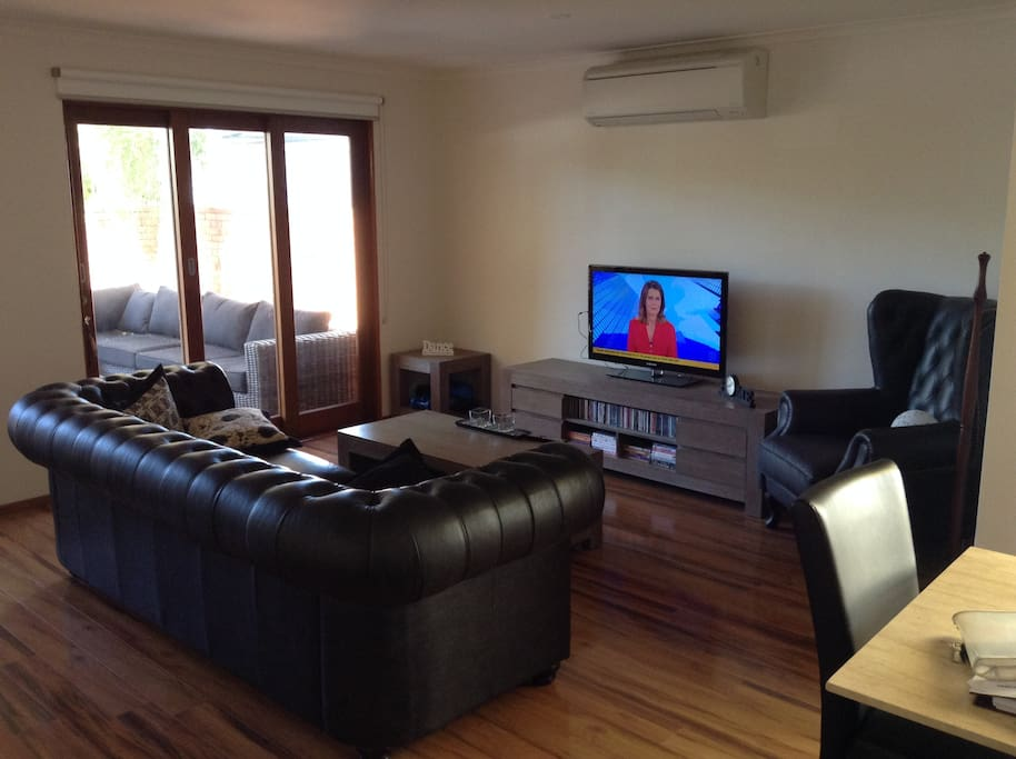 Lounge room with split system air-conditioning for cooling and heating