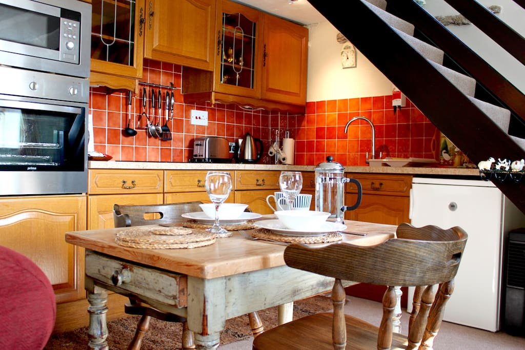 Wine and dine in the lovely well equipped kitchen for the perfect night in.