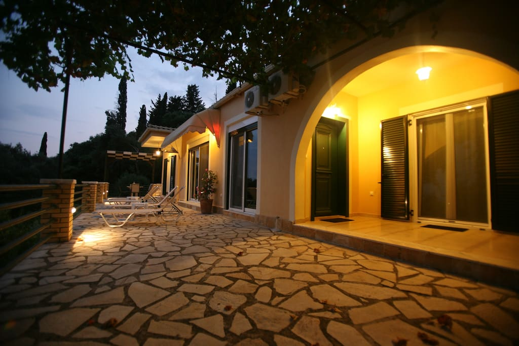 the patio of the Villa in the evening