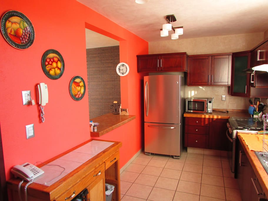 Lovely bright kitchen with lots of space for chef.