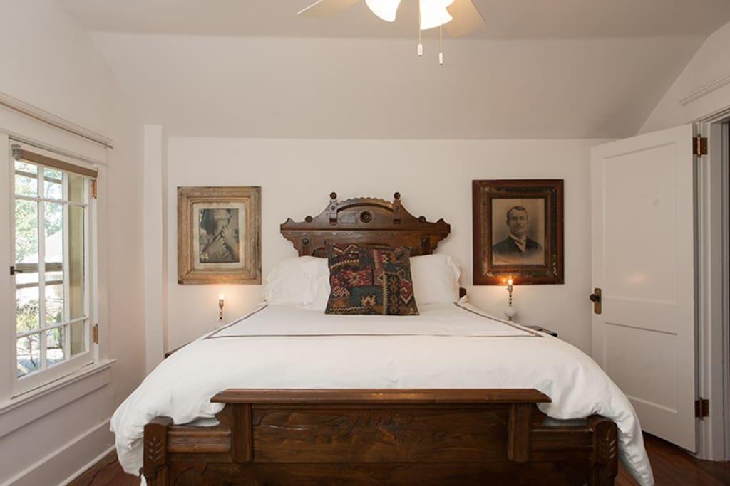 Upstairs master bedroom with antique queen bed, flat screen tv