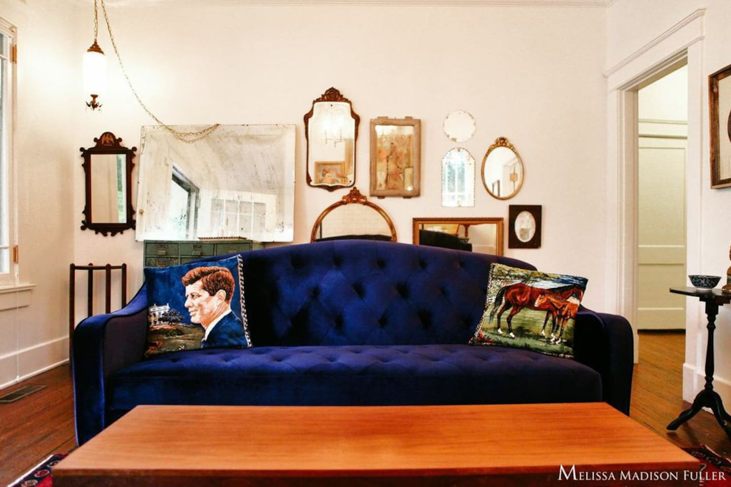 Living room with one of a kind vintage pieces. New velvet couch turns into a sleeper sofa if needed