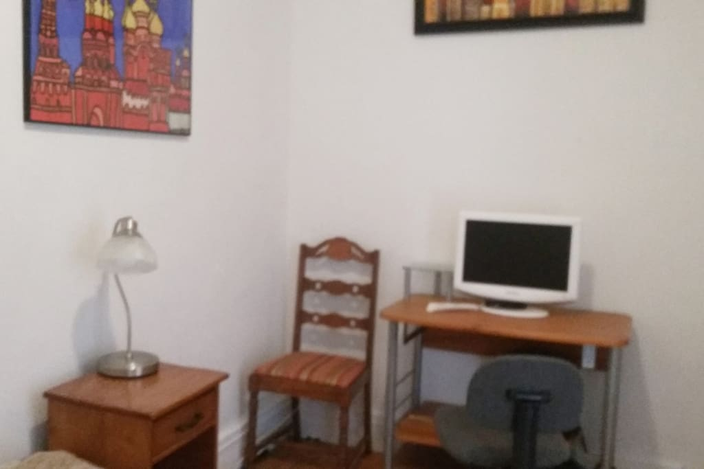 Bedroom comes with a desk, office chair and a TV