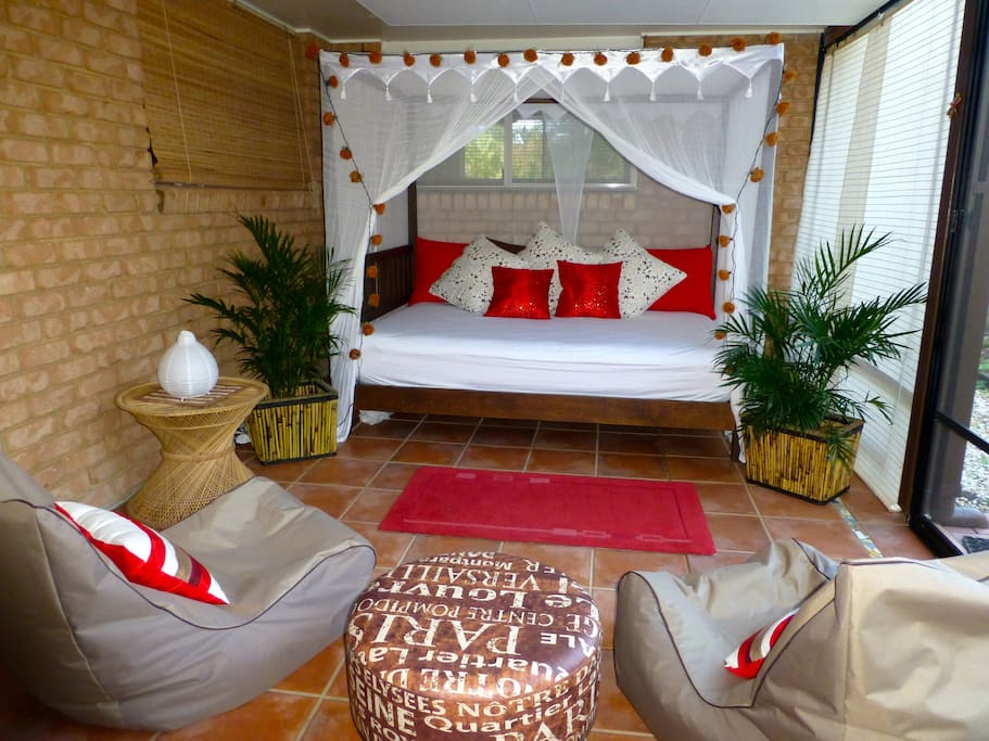 Our outside screened in room with daybed and bean bags. A great place to relax