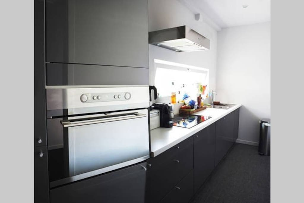 Fully equiped shared kitchen, with dishhwasher, microwave, hot air oven, fridge and deep freezer.