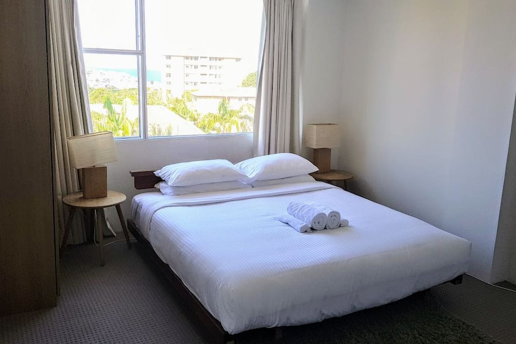 Master bedroom: king bed and view to Bondi
