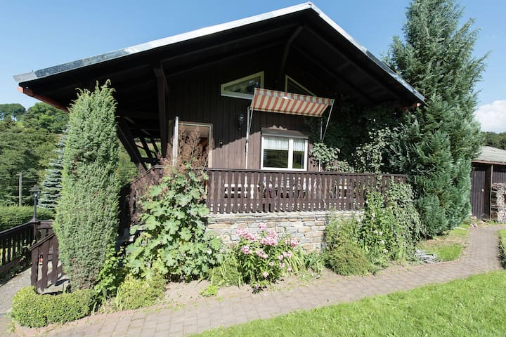 Cosy holiday home in the Erzgebirge mountains with large garden and terrace