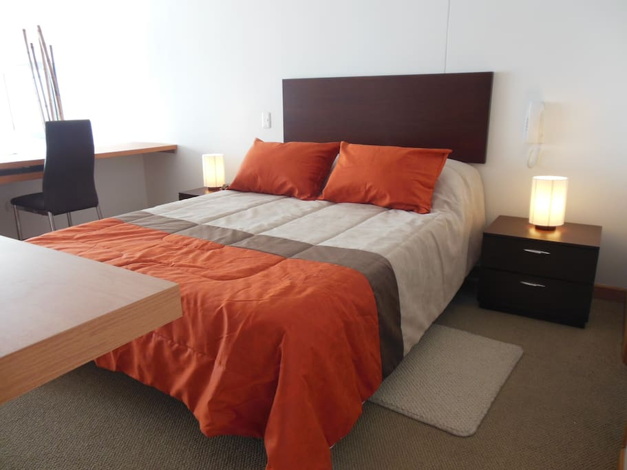 Bedroom has walk-in closet and includes flat screen TV with cable