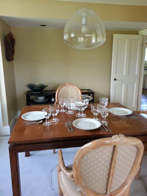 Dining table extends to accommodate 8-10.