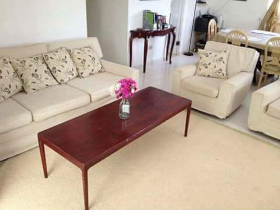 Very spacious open plan living and dining area through   to patio .. dinning table for 6.