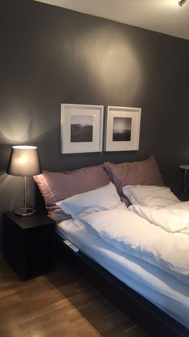 Bedroom with queen size bed, Smart TV and desk